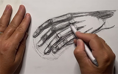 two hands--drawing a hand in charcoal