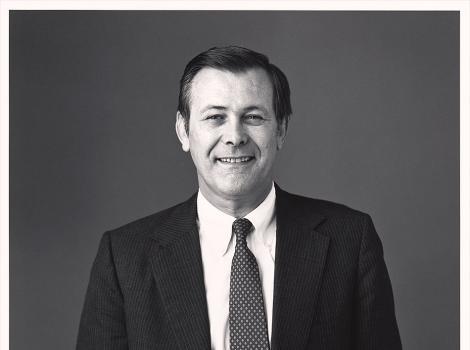 Waist length portrait of a man in a dark suit