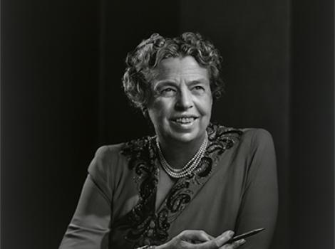 black and white photo of a woman with her arms crossed