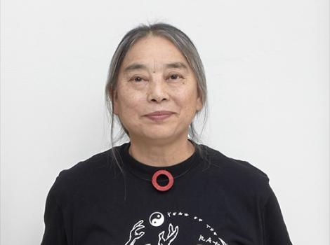 Detail photo of an Asian woman in a black shirt