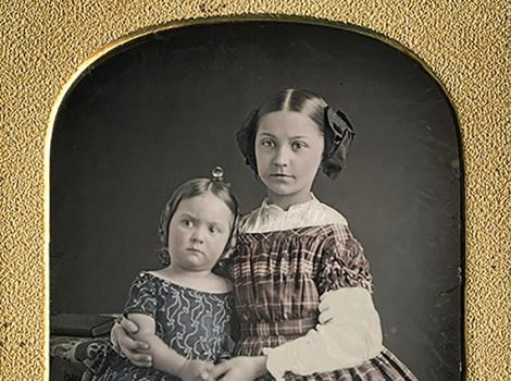 two small girls in patterned dresses