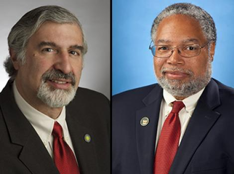 bust-length photos of two men in dark suits with red ties