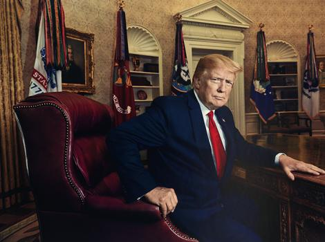 Man seated in a large leather chair in the Oval Office