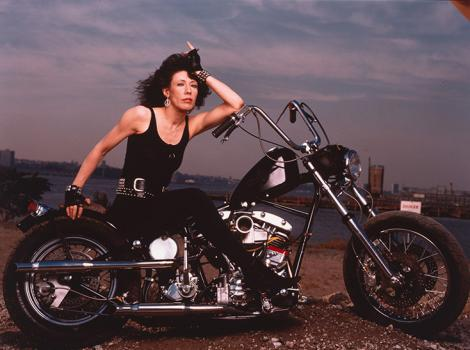 woman in black on a black motorcycle
