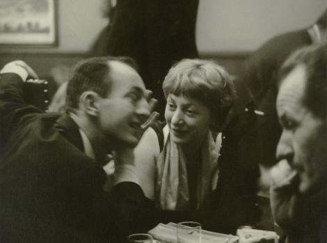 Three people talking in a cafe