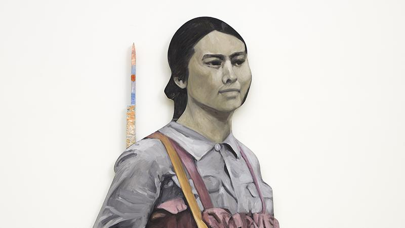 Young Chinese woman with a backpack and a rifle