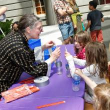 Docent working with children on crafts