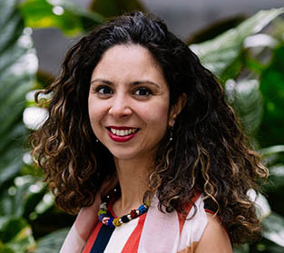 Young woman with curly hair in a colorful dress
